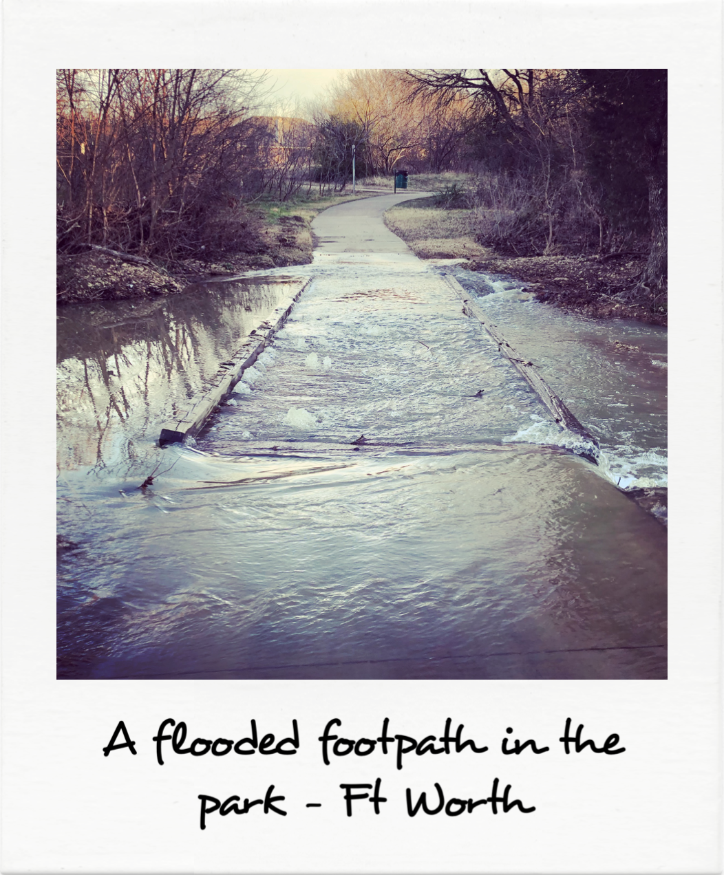 A flooded footpath in the park - Ft Worth